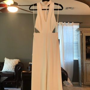 High neck jumpsuit with side cutouts.